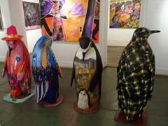 Colorfully clad penguins for sale; Ushuaia prison/maritime museum