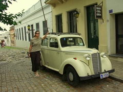 Becky posing next to one of Colonia's antique cars