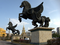"Massive bronze horse statues, known as ""Muelle de los Pegasos"" greet us as we wander towards the old city of Cartagena, an infamous slave port"