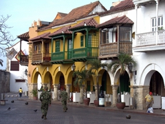 Soldiers casually strolling through picturesque Plaza de los Coches