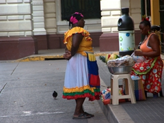 "An early morning discussion between two ""Palenqueras"", iconic Afro-Colombian fruit vendors"