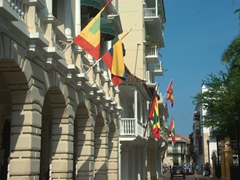 Cartagena and Colombia flags adorn an old colonial building; Plaza de Bolivar