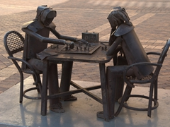 Chess players deep in contemplation; Square outside Iglesia de San Pedro Claver