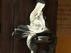 Ornate fish door knocker