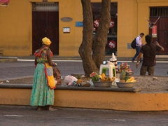 Vendors get ready for a long day at Plaza de Santo Domingo