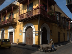 A man and his pushcart weave their way through old Cartagena