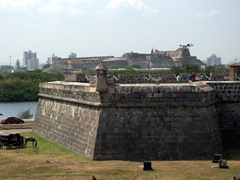 View of Cartagena's city walls with the fortress of Castillo San Felipe de Barajas visible in the background