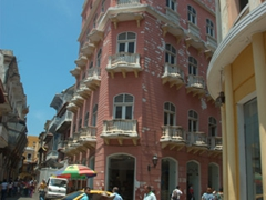 This architecturally interesting pink corner building caught our attention in old Cartagena