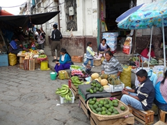 Street side vendors with a wide variety of fruits and vegetables for sale