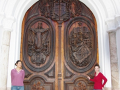 Posing in front of the ornately carved wooden doors of La Iglesia de la Merced de los Padres Oblatos