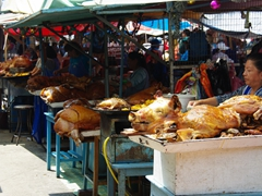 "Large ""hornado"" for sale at the market. Hornado is a pig that has been roasted whole in a special oven for a deep, rich flavor"