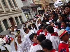 The streets are packed for the Pase del Niño Viajero