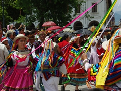 Colorful outfits of Pase del Niño Viajero parade