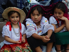 Cute girls sitting in the shade; Pase del Niño Viajero