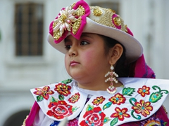 Ornately costumed girl in the Pase del Niño Viajero