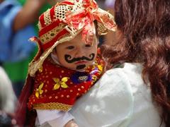 A mustachioed baby; Pase del Niño Viajero