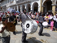 A marching band performs during the Pase del Niño Viajero