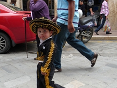 This cute little kid is dressed to the nines during the Pase del Niño Viajero