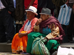 Two indigenous women check out the festivities; Pase del Niño Viajero