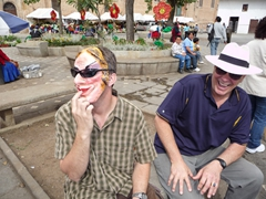 Robby freaks out little kids by pretending to pick his nose; near the flower market at Monastery of El Carmen de Asuncion