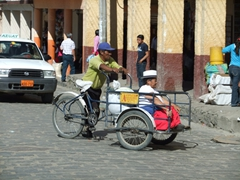 Catching a ride home after all day shopping at Gualaceo Market