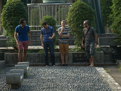 The boys walk barefoot on stones; 228 Peace Park