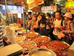 Sampling street food treats; Huaxi Night Market