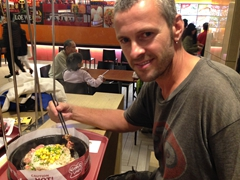 Robby enjoying his sizzling hot plate; Taipei 101 food court