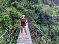 Becky on a suspension bridge spanning the gorge