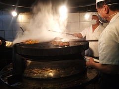Chefs preparing our Mongolian BBQ meal; Tang Kung restaurant
