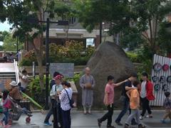 Monk seeking alms on Tamsui Old Street