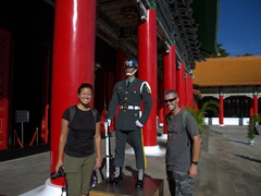 Posing with a guard at the National Revolutionary Martyrs' Shrine; Taipei
