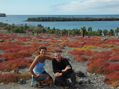 "Posing in front of the beautiful red hues of the ""Galapagos Carpet""; South Plazas"