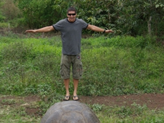 Luke pretending to stand on a giant tortoise (he is actually about 6 feet behind it, keeping a respectful distance from the wildlife is mandatory in the Galapagos)
