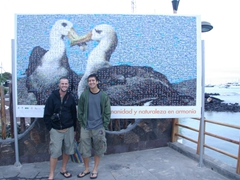 Awww, how cute! Robby and Luke stand in front of a poster of a pair of loving albatross birds; Santa Cruz