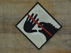 A sign reminding visitors not to touch the giant tortoises; Santa Cruz