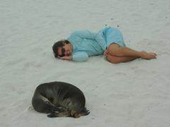 Becky mimics a sea lion's pose; Gardner Bay