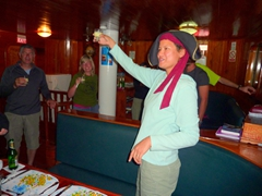 Becky leads the group (in Spanish) for the farewell toast...the silly pirate hat is NOT her idea!
