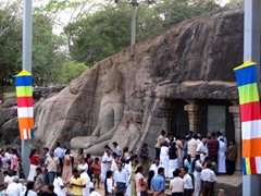 Crowds of people at one of Sri Lanka's foremost attractions, the carved Buddhas at Gal Vihare