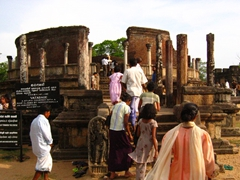 Buddhists entering the Polonnaruwa Vatadage, believed to hold the tooth relic of Buddha