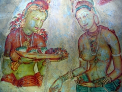 Quite possibly the most famous of all the wall paintings at Sigiriya, the beautiful apsaras (celestial nymphs)