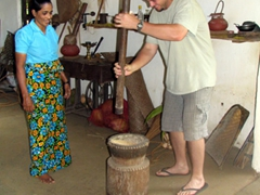 Robby learning to pound rice in Kandy
