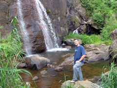 Robby beside one of Hunas Falls' many waterfalls