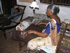 An elderly woman demonstrates the workmanship of making a lace table cloth, Galle Fort