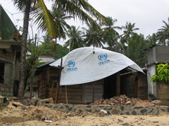 Evidence of the aftermath of the 2004 tsunami, UNHCR reconstruction project, Unawatuna Beach