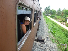 Becky smiles as she enjoys the train ride from Colombo to Hikkaduwa (our ride cost just over $1)