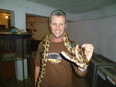 Robby holds a snake at the reptile section of the Dehiwala Zoo