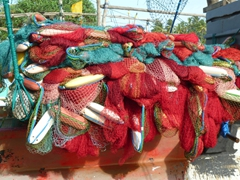 Colorful fishing nets catch our attention; near Galle
