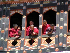 Young monks observing the Paro Tsechu from above