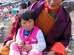 This proud mother asked me to take a photo of her daughter, Paro Tsechu